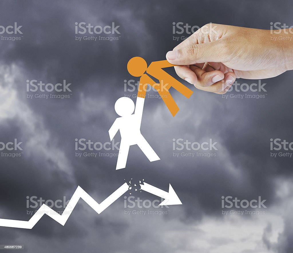 Leader helping a businessman from crisis stock photo