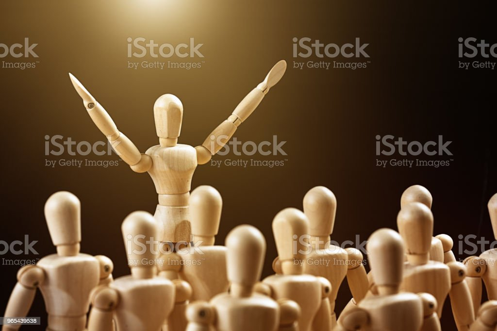 Leader waves his arms as he speaks to a crowd royalty-free stock photo