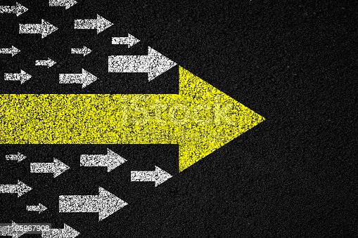 istock Leadership arrows on asphalt background 1125967908