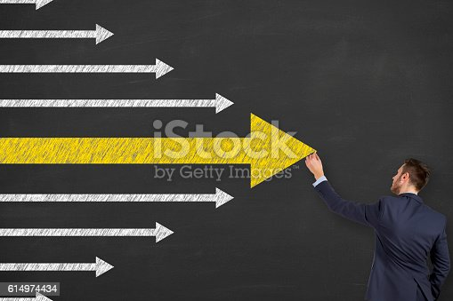 istock Leadership Concept Arrows on Chalkboard Background 614974434