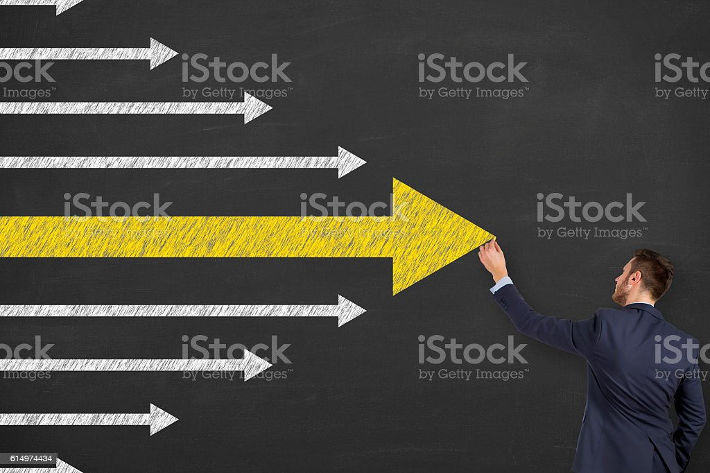 Leadership Concept Arrows on Chalkboard Background stock photo