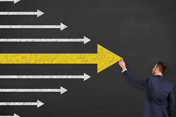 Leadership Concept Arrows on Chalkboard Background ストックフォト