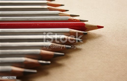 Red pencil among usual ones