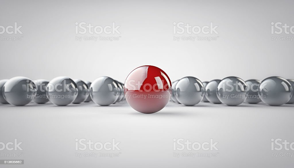 Leadership Concept. Red Metal Sphere in the focus and chrome spheres...