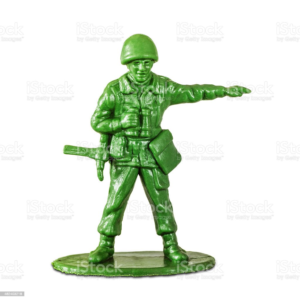 Leadership concept with little soldier toy on white background aiming stock photo