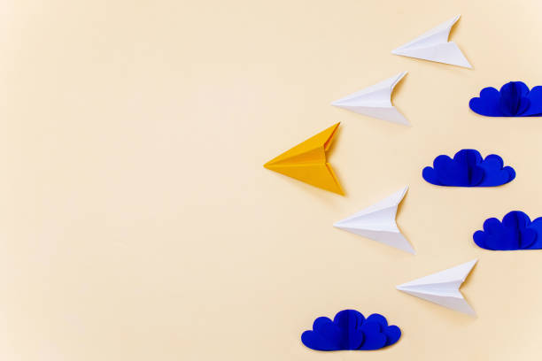 Leadership concept with origami paper planes and 3d clouds. Creative concept for banner/landing page/background. stock photo