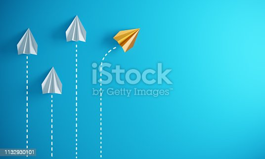 Group of paper plane in one direction and with one individual pointing in the different way, can be used leadership/individuality concepts.( 3d render )