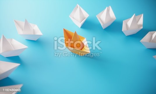 Circle of paper boats, and orange colored one standing out from the crowd, can be used leadership/individuality concepts.( 3d render )