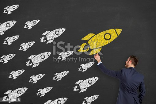 istock Leadership concept with rocket on chalkboard background 628618816