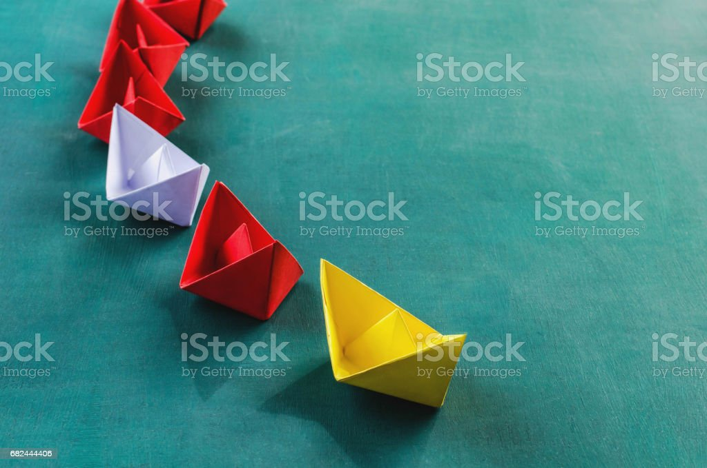 Leadership concept yellow leader paper boat royalty-free stock photo