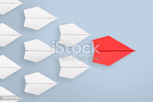 istock Leadership concepts with blue paper airplane 905396290