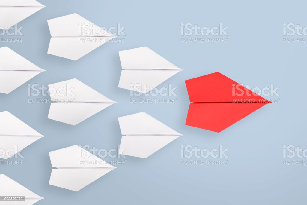 Leadership concepts with blue paper airplane stock photo
