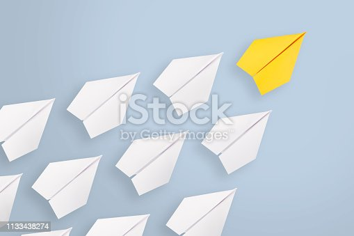 istock Leadership concepts with yellow paper airplane leading among white 1133438274
