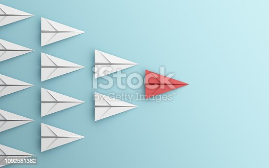 istock leadership or different concept with red and white paper airplane on blue background. Digital craft in education or travel concept. Mock up design. 3d abstract illustration 1092581362