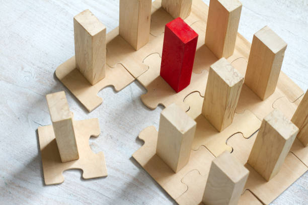 Leadership team and new employee abstract business concept with puzzle and block stock photo