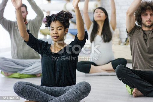 637804152istockphoto Leading a Breathing Exercise in Yoga Class 681169290