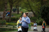 A pregnant fitness instructor leads the way for the mothers and babies on her exercise bootcamp.