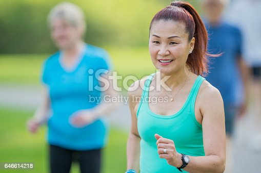 646614234 istock photo Leading a Fitness Walk 646614218
