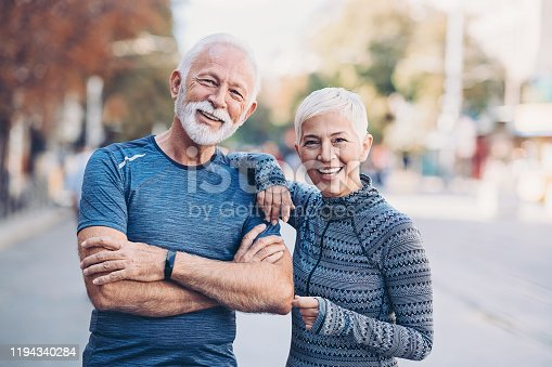Portrait of a senior couple in sportswear outdoors in the city