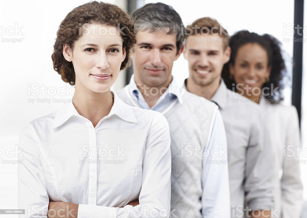 Leading her team to the top royalty-free stock photo