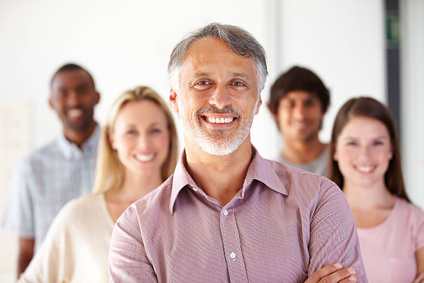 Leading his team by example stock photo