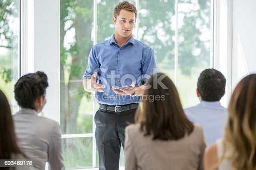 600073884 istock photo Leading the Discussion 693469176