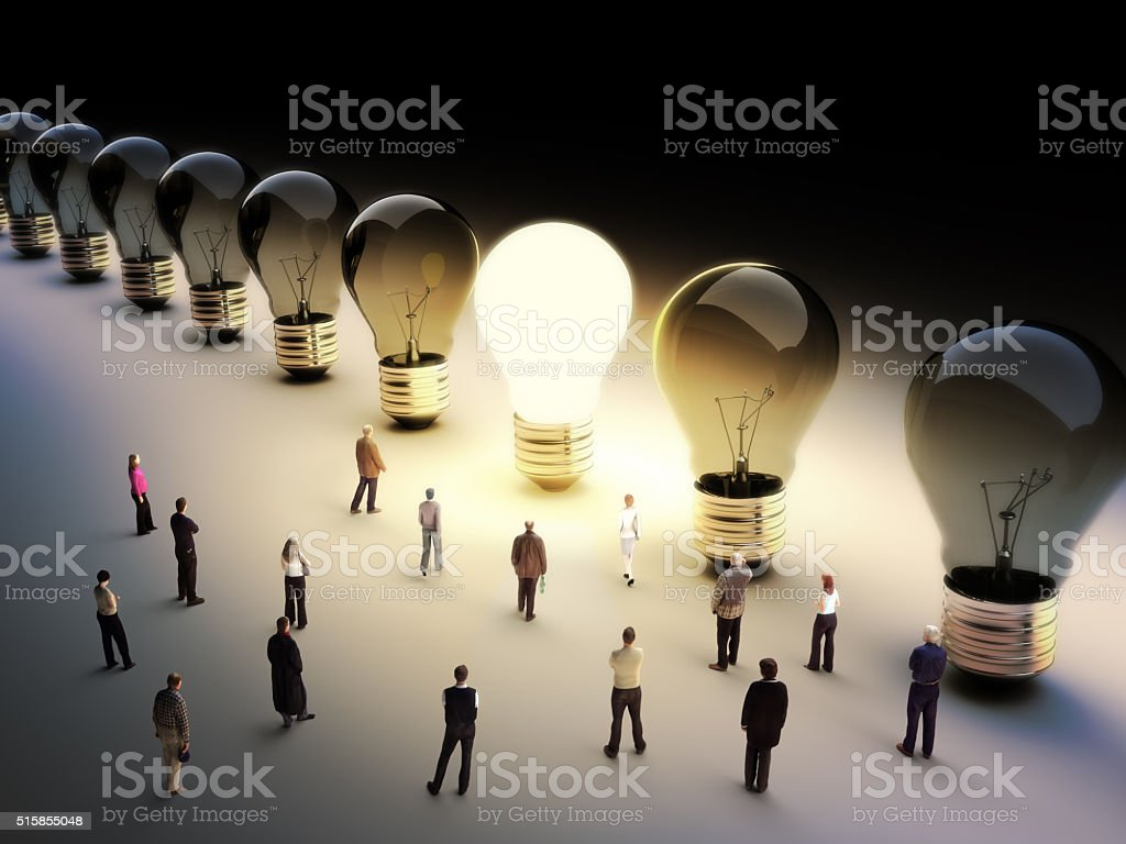 Light bulbs in a row with one being on, large group of people with a...