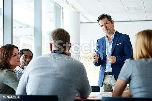 istock Leading the team through his business plan 597639824