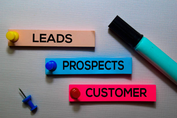 Leads, Prospects, Customer text on sticky notes isolated on office desk stock photo