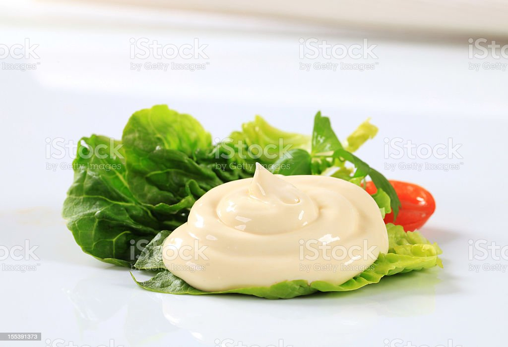 Leaf of lettuce with tomato and mayonnaise stock photo