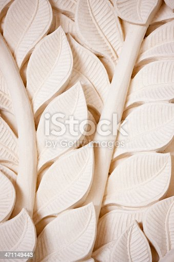 Leaf pattern bas relief stone carving background ornate