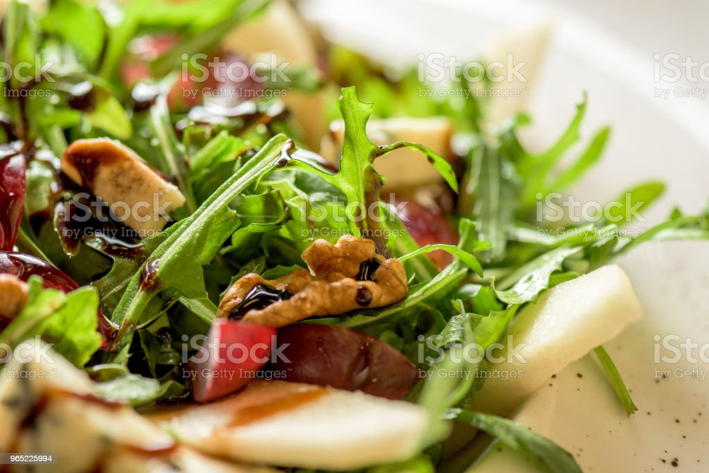 Leaf vegetable salad with cheese, grapes, walnuts and tasty sauce. Healthy, diet food royalty-free stock photo