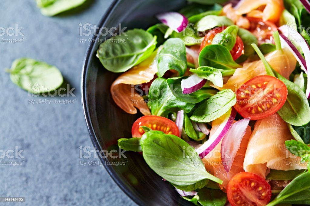 Leaf vegetable salad with smoked salmon stock photo