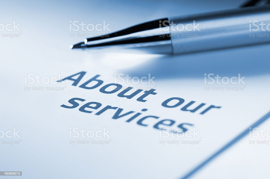 Leaflet about our services with ballpoint pen royalty-free stock photo