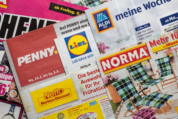Leaflets and flyers of German discount market chains Amberg, Germany - February 26, 2018: Advertising leaflets of some German discount market chains. Logos and brands are visible. Lidl, Aldi Süd, Penny Markt, Norma, Netto. discount store stock pictures, royalty-free photos & images