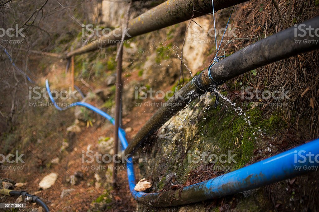 leak from pipe stock photo
