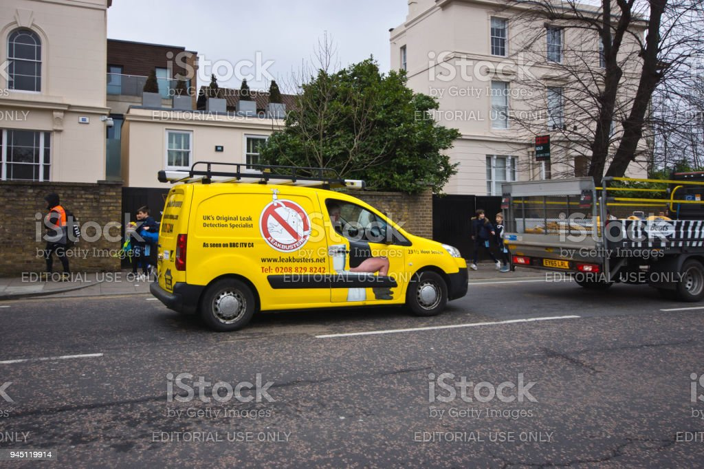 A leakbuster van at traffic lights stock photo