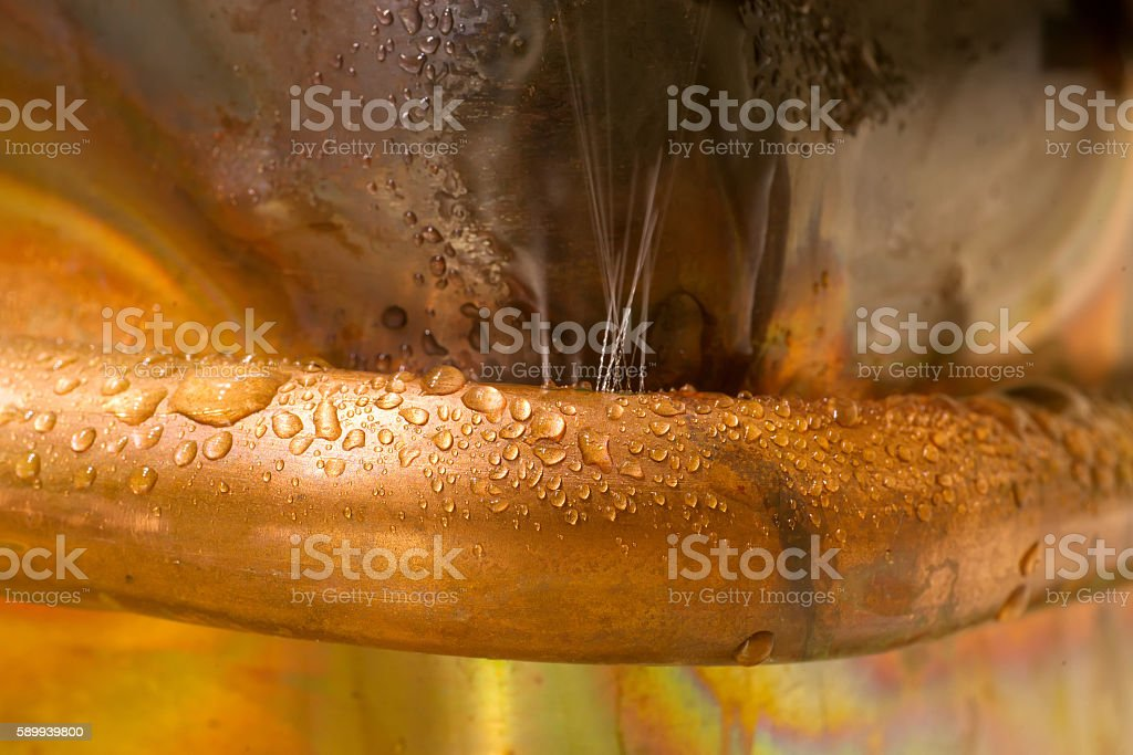 Leaking copper pipe stock photo