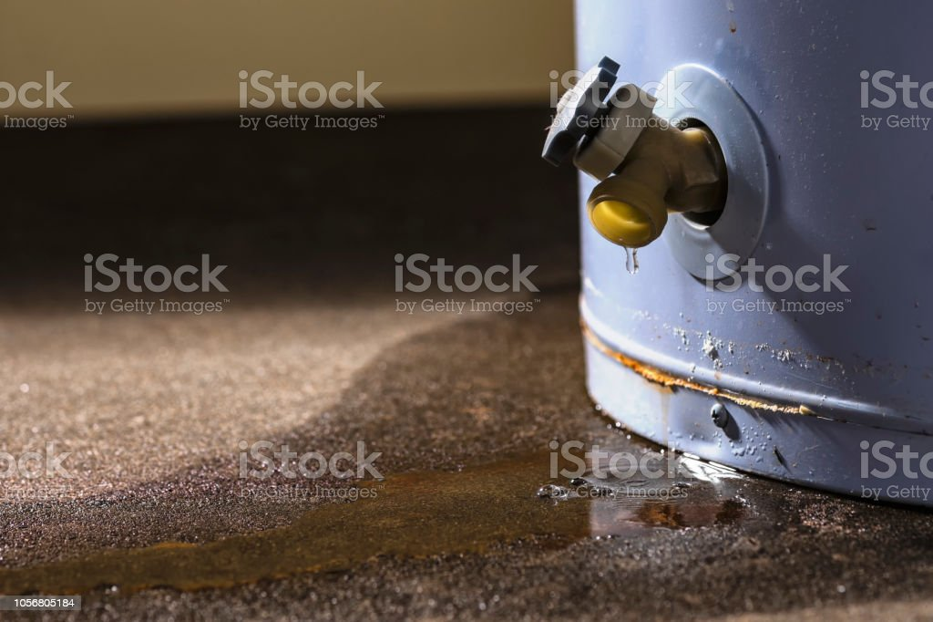 A leaking faucet on a domestic water heater stock photo
