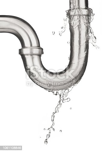 Leaking of water from stainless steel sink pipe on isolated on white background