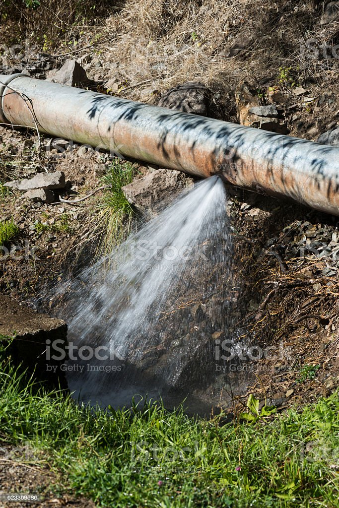 Leaking water pipe stock photo