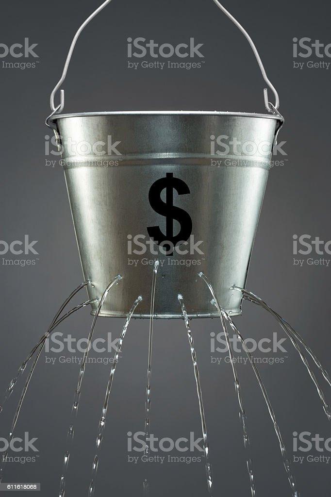 Leaky Dollar Bucket stock photo