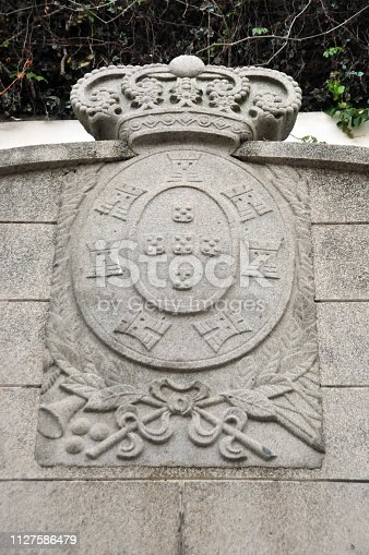 Macau, China: detail of an 18th century fountain in the garden of the Leal Senado Building - former seat of Portuguese Macau's government (Legislative Assembly of Macau and Municipal Council of Macau) - Senado Square, Historic Centre of Macau - currently used for the Institute of Civic and Municipal Affairs - Portuguese coat of arms