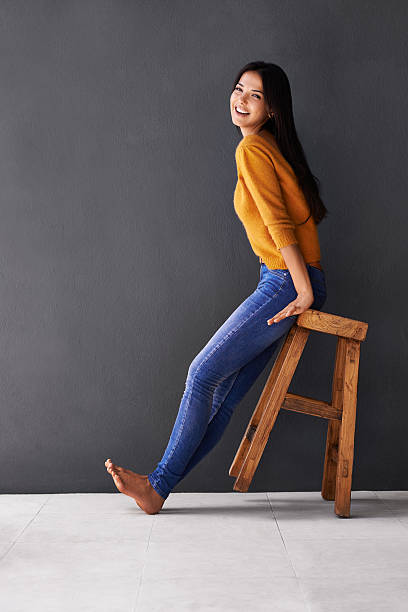 I lean towards the lighter side of life Portrait of a happy young woman leaning sitting on a stool that's tilted backhttp://195.154.178.81/DATA/i_collage/pi/shoots/783562.jpg skinny jeans stock pictures, royalty-free photos & images