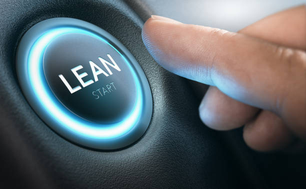 Lean Transformation and Management Concept Finger about to start Lean Transformation by pressing a push button. Composite image between a hand photography and a 3D background. leaning stock pictures, royalty-free photos & images