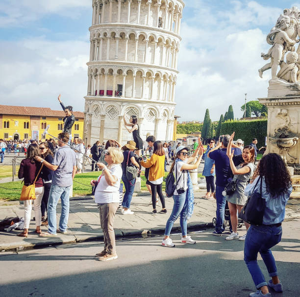 Leanding Tower of Pisa - Posing for photos stock photo