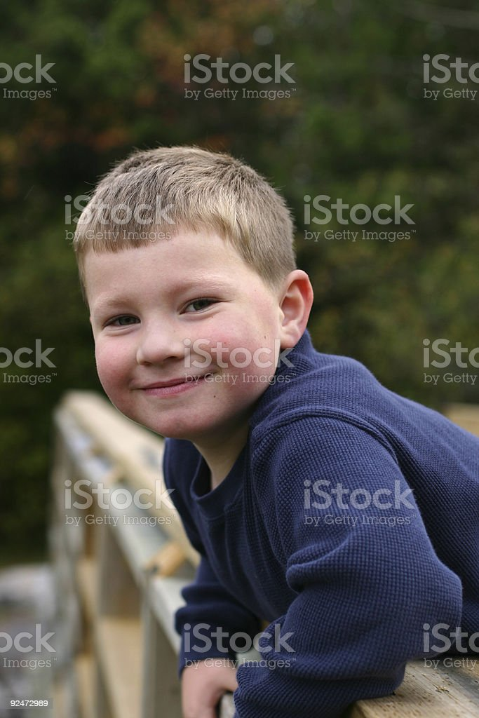 Leaning on a Bridge royalty-free stock photo
