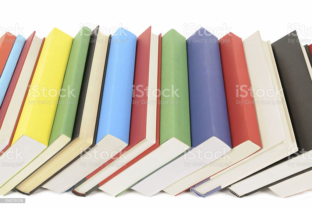 Leaning row of colorful books royalty-free stock photo