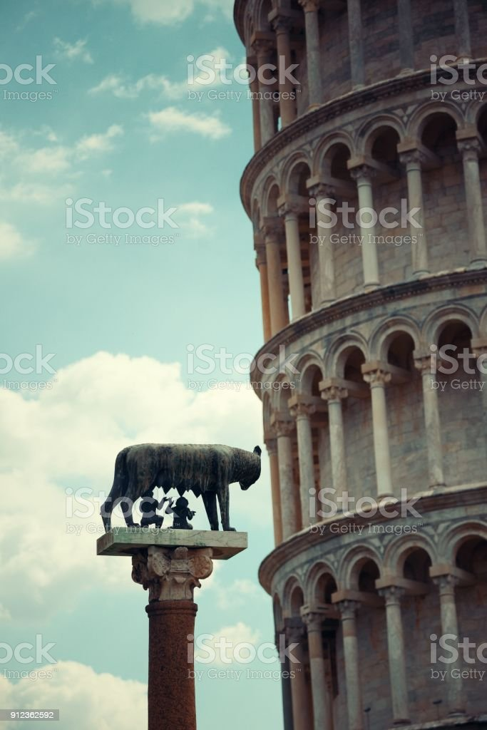 Leaning tower Capitoline wolf in Pisa stock photo