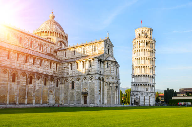 Leaning Tower of Pisa at sunset Sunset view of Leaning Tower of Pisa and Cathedral, Tuscany, Italy pisa stock pictures, royalty-free photos & images